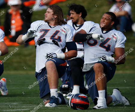 Ty Sambrailo, Shelley Smith Denver Broncos offensive tackle Ty Sambrailo and guard Shelley Smith during drills at the team's NFL football training camp session, in Englewood, Colo