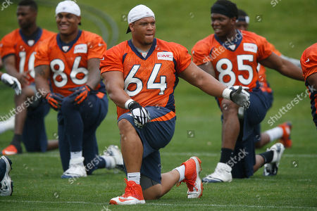 Shelley Smith Denver Broncos guard Shelley Smith stretches during an NFL minicamp at the team's headquarters, in Englewood, Colo