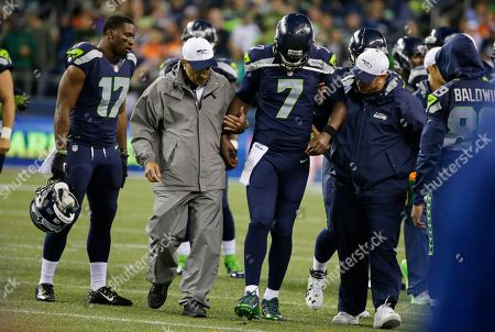 Tarvaris Jackson Seattle Seahawks quarterback Tarvaris Jackson (7) is helped off the field after going down with an injury in the second half of a preseason NFL football game against the Denver Broncos, in Seattle