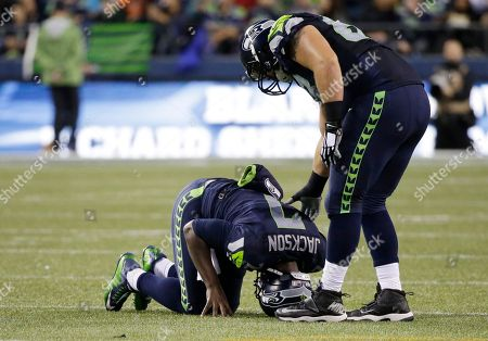 Tarvaris Jackson Seattle Seahawks quarterback Tarvaris Jackson rests on the turf as teammate Mark Glowinski, right, looks on after Jackson suffered an injury in the second half of a preseason NFL football game against the Denver Broncos, in Seattle