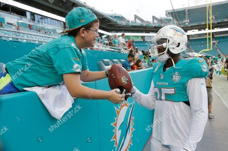 Sholom Laber Sholom Laber, 10 of Miami beach gets his football signed by Miami Dolphins wide receiver Greg Jennings (85) before an NFL preseason football game against the Tampa Bay Buccaneers, in Miami Gardens, Fla