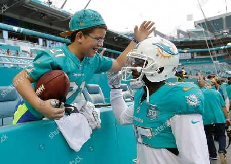 Sholom Laber Sholom Laber, 10 of Miami Beach thanks Miami Dolphins wide receiver Greg Jennings (85) before an NFL preseason football game against the Tampa Bay Buccaneers, in Miami Gardens, Fla