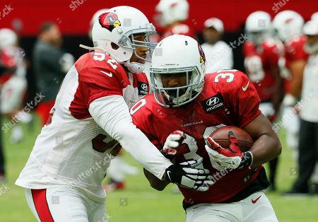 Stephan Taylor, LaMarr Woodley Arizona Cardinals' Stephan Taylor (30) LaMarr Woodley (52) work out during an NFL football training camp, in Glendale, Ariz