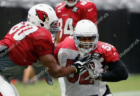 Ifeanyi Momah, LaMarr Woodley Arizona Cardinals' Ifeanyi Momah, left, blocks LaMarr Woodley, right, during an NFL football training camp practice, in Glendale, Ariz