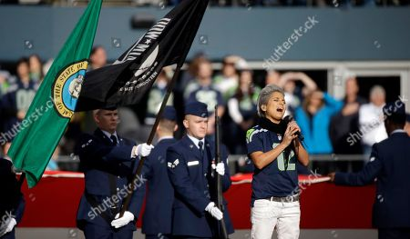 Vicci Martinez Vicci Martinez sings the national anthem before an NFL football game between the Seattle Seahawks and Arizona Cardinals, in Seattle