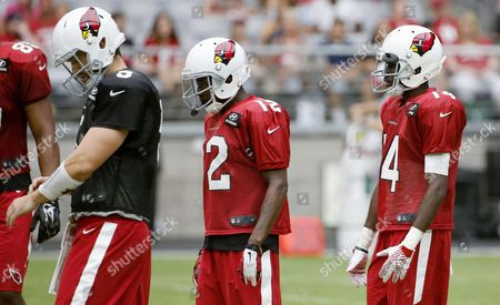John Brown, J.J. Nelson, Drew Stanton Arizona Cardinals wide receivers J.J. Nelson (14) and John Brown (12) arrive in the huddle behind quarterback Drew Stanton, left, during NFL football training camp, in Glendale, Ariz. The two receivers
