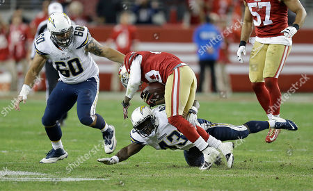 Chris Culliver, Branden Oliver San Francisco 49ers defensive back Chris Culliver, center, is tackled by San Diego Chargers running back Branden Oliver (43) after intercepting a pass by quarterback Philip Rivers during the second half of an NFL football game in Santa Clara, Calif