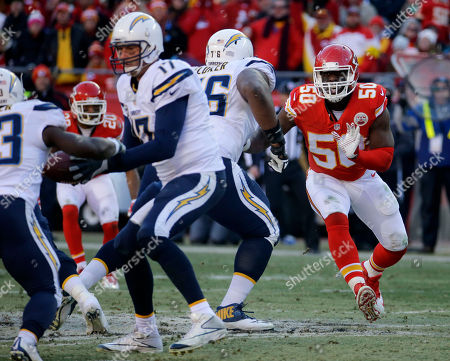 Justin Houston, D.J. Fluker, Philip Rivers, Branden Oliver Kansas City Chiefs outside linebacker Justin Houston (50) tries to get around San Diego Chargers tackle D.J. Fluker (76), as San Diego Chargers quarterback Philip Rivers (17) hands off the ball to San Diego Chargers running back Branden Oliver (43), during the second half of an NFL football game in Kansas City, Mo