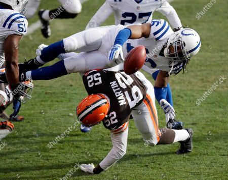 Josh Cribbs, Eric Martin Indianapolis Colts' Josh Cribbs fumbles on a kick return on a hit from Cleveland Browns linebacker Eric Martin (52) in the second quarter of an NFL football game, in Cleveland
