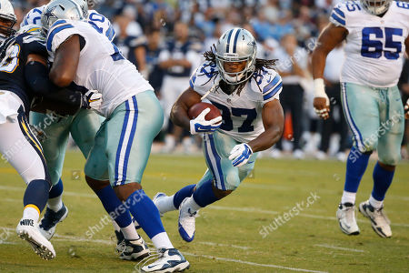 Gus Johnson Dallas Cowboys running back Gus Johnson runs with the ball against the San Diego Chargers during the first half of an NFL preseason football game in San Diego