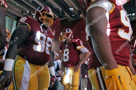 Kirk Cousins, Terrance Knighton Washington Redskins quarterback Kirk Cousins (8) waits with defensive tackle Terrance Knighton (98) nearby, to enter the field before an NFL football game against the Miami Dolphins, in Landover, Md