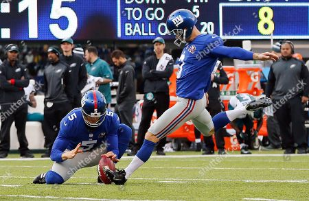 Josh Brown New York Giants' Josh Brown (3) kicks a field goal from the hold of punter Steve Weatherford (5) during the first half of an NFL football game against the Philadelphia Eagles, in East Rutherford, N.J