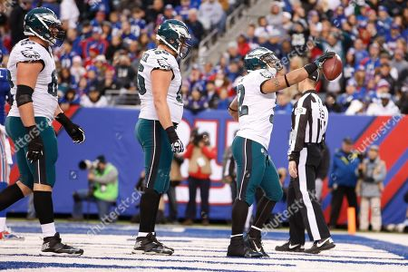 Chris Polk Philadelphia Eagles' Chris Polk (32) celebrates with teammates Andrew Gardner (66) and Lane Johnson (65) after scoring a touchdown during the second half of an NFL football game against the New York Giants, in East Rutherford, N.J