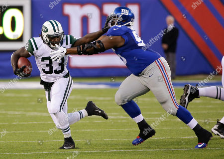 Stock Image of Chris Ivory New York Jets running back Chris Ivory (33) stiff arms New York Giants tackle Will Beatty (65) during the first half of a preseason NFL football game in East Rutherford, N.J