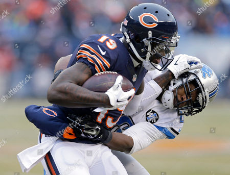 Josh Morgan, Don Carey Chicago Bears eceiver Josh Morgan (19) tries to push off Detroit Lions safety Don Carey (26) after catching a pass in the second half of an NFL football game, in Chicago