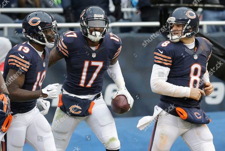Alshon Jeffery, Josh Morgan, Jimmy Clausen Chicago Bears receiver Alshon Jeffery (17) celebrates a touchdown reception with receiver Josh Morgan (19) and quarterback Jimmy Clausen (8) in the second half of an NFL football game against the Detroit Lions, in Chicago