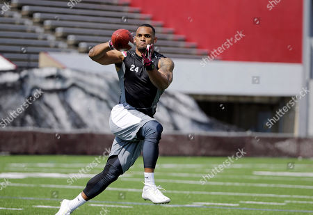 John Griffin Former New York Jets running back John Griffin catches a football at a Pro Day for NFL and CFL football scouts at McGuirk Stadium in Amherst, Mass