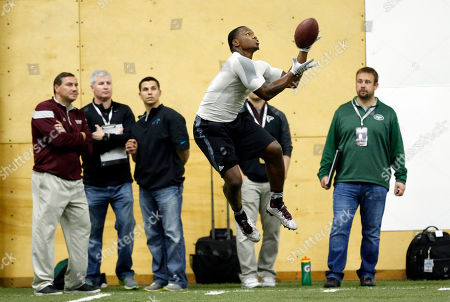 Nick Griffin, Dan Mullen Former Mississippi State running back Nick Griffin leaps to catch a pass during position drills at Pro Day at Mississippi State in Starkville, Miss., while his former coach, Dan Mullen, left, watches. Mullen attended the event and offered encouragement to a number of players. The event showcases players for the upcoming NFL football draft