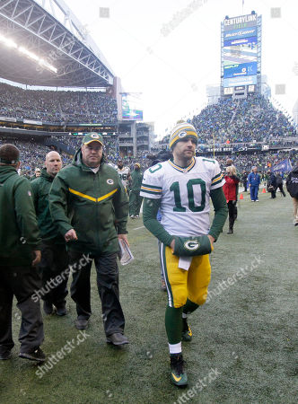 Green Bay Packers head coach Mike McCarthy and Matt Flynn leave the field after an NFL football NFC Championship game against the Seattle Seahawks, in Seattle. The Seahawks won 28-22 to advance to Super Bowl XLIX