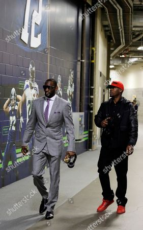 Ricardo Lockette, Tarvaris Jackson Seattle Seahawks' Ricardo Lockette, left, and Tarvaris Jackson arrive before the NFL football NFC Championship game against the Green Bay Packers, in Seattle