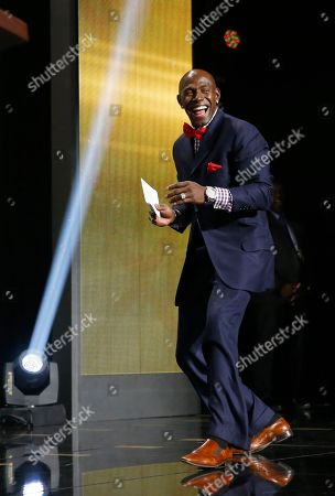 Stock Photo of Former Green Bay Packers wide receiver Donald Driver smiles as he walks on the stage to announce that the Packers selects Miami of Ohio defensive back Quinten Rollins as the 62nd pick in the second round of the 2015 NFL Football Draft, in Chicago