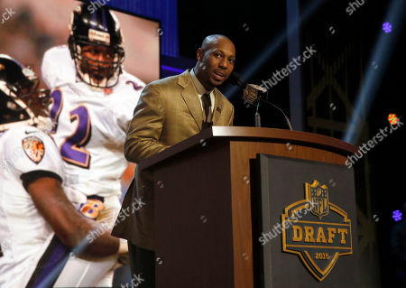 Stock Image of Former NFL player Duane Starks announces that the Baltimore Ravens selects Minnesota tight end Maxx Williams as the 55th pick in the second round of the 2015 NFL Football Draft, in Chicago