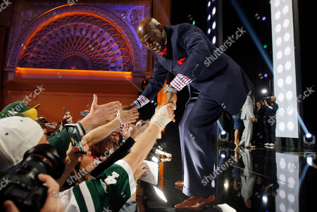 Stock Picture of Former Green Bay Packers wide receiver Donald Driver greet fans after announcing that the Packers selects Miami of Ohio defensive back Quinten Rollins as the 62nd pick in the second round of the 2015 NFL Football Draft, in Chicago