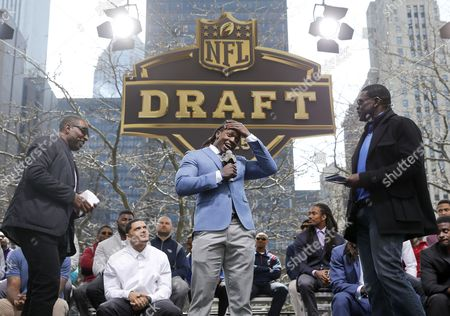 Michael Irvin, Melvin Gordon, Chris Carter Cris Carter, left, and Michael Irvin, right, interview Wisconsin running back Melvin Gordon during introductions at a pre-draft rally of 2015 NFL Draft prospects, and various league legends at Pioneer Court, in Chicago