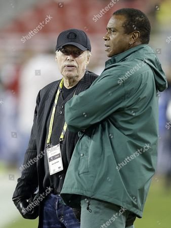 Phil Knight, Ahmad Rashad Co-founder and chairman of Nike, Inc. Phil Knight, left, speaks with former NFL football player Ahmad Rashad prior to the Pac-12 Conference championship NCAA college football game against, in Santa Clara, Calif