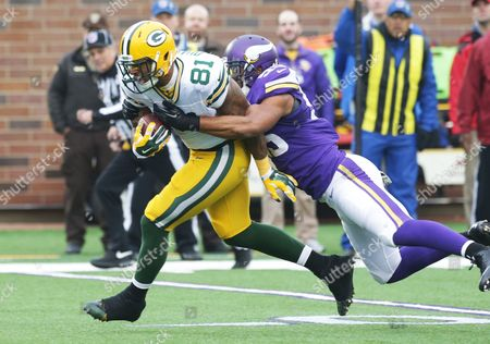 Andrew Quarless, Anthony Barr Minnesota Vikings outside linebacker Anthony Barr, right, tackles Green Bay Packers tight end Andrew Quarless during the first half of an NFL football game, in Minneapolis