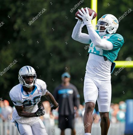 Greg Jennings, Bene' Benwikere Miami Dolphins' Greg Jennings (85) catches a pass as Carolina Panthers' Bene' Benwikere (25) defends during a joint practice at the Panthers' training camp in Spartanburg, S.C