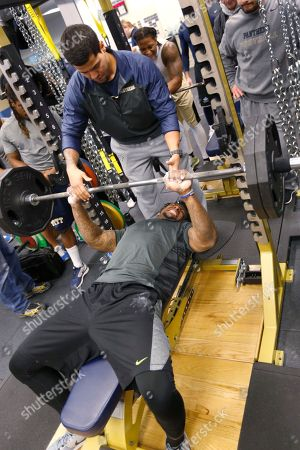 Todd Thomas Pittsburgh linebacker Todd Thomas, bottom, grimaces as he repeatedly bench presses 225 pounds during Pro Day at the NCAA football team's indoor training center, in Pittsburgh. The event is to showcase players for the upcoming NFL football draft