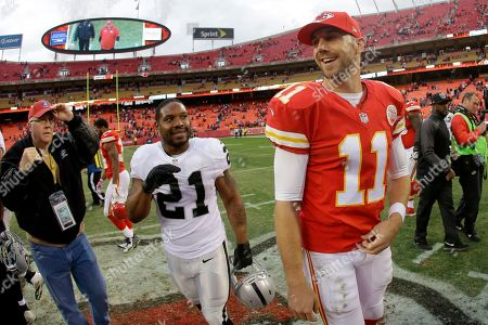 Alex Smith, Maurice Jones-Drew Kansas City Chiefs quarterback Alex Smith (11) and Oakland Raiders running back Maurice Jones-Drew (21) talk after their NFL football game, in Kansas City, Mo. The Chiefs won 31-13