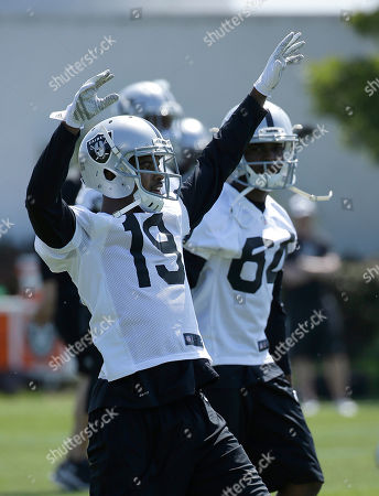 Josh Harper Oakland Raiders wide receiver Josh Harper (19) stretches during a rookie minicamp at an NFL football facility in Alameda, Calif