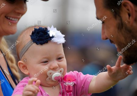 Andrew Gachkar Dallas Cowboys linebacker Andrew Gachkar, right, talks with his wife Lauren and baby Brooklyn during a joint NFL football training camp with the St. Louis Rams, in Oxnard, Calif