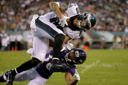 Philadelphia Eagles' Jeff Maehl (88) collides with Baltimore Ravens' Rashaan Melvin (38) after a catch during the first half of a preseason NFL football game, in Philadelphia