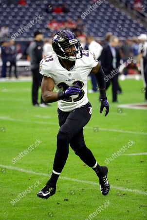 Stock Image of Baltimore Ravens cornerback Antoine Cason (23) warms up before an NFL football game against the Houston Texans, in Houston