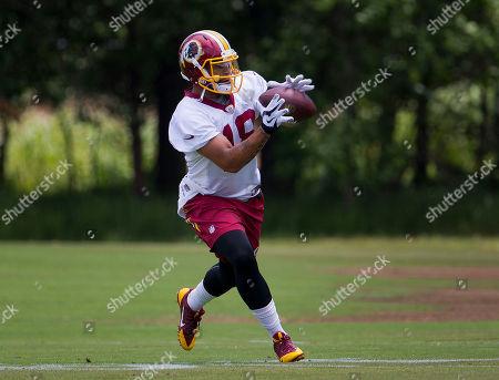 Reggie Bell Washington Redskins Reggie Bell (18) takes part in drills during NFL football minicamp at Redskins Park in Ashburn, Va
