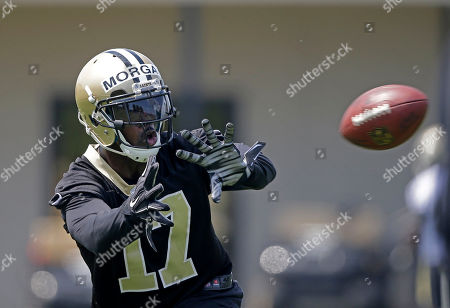 Josh Morgan Taken, New Orleans Saints wide receiver Josh Morgan (17) works out during an NFL football organized team activity in Metairie, La. While veteran receiver Morgan is by no means assured of a roster spot in New Orleans, he is certain he made the right decision to sign with the Saints