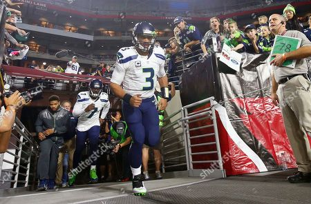 Russell Wilson, Tarvaris Jackson Seattle Seahawks' Russell Wilson (3) and Tarvaris Jackson (7) run out on the field prior to an NFL football game against the Arizona Cardinals, in Glendale, Ariz