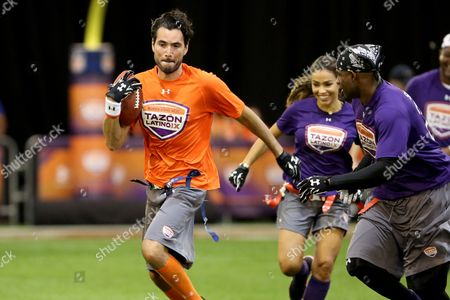 Khotan Fernandez AFC Team's Khotan Fernandez avoids a tackle against the NFC Team in the Tazon Latino IX at the NFL Experience on in Phoenix