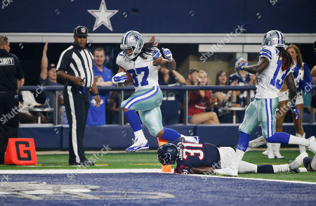 Gus Johnson, Charles James Dallas Cowboys running back Gus Johnson (37) scores over Houston Texans defensive back Charles James (31) during the second half of a preseason NFL football game, in Arlington, Texas