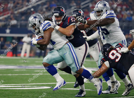 Gus Johnson, Max Bullough Dallas Cowboys running back Gus Johnson (37) is tackled by Houston Texans inside linebacker Max Bullough (53) during the first half of a preseason NFL football game, in Arlington, Texas