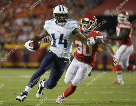 Jamell Fleming, Hakeem Nicks Tennessee Titans wide receiver Hakeem Nicks (14) is pursued by Kansas City Chiefs defensive back Jamell Fleming (30) during the first half of a preseason NFL football game at Arrowhead Stadium in Kansas City, Mo