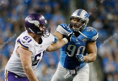 Ndamukong Suh, Joe Berger Detroit Lions defensive tackle Ndamukong Suh (90) goes up against Minnesota Vikings guard Joe Berger (61) during the second half of an NFL football game at Ford Field in Detroit