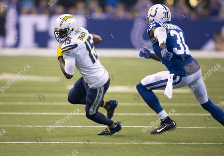 San Diego Chargers wide receiver Dontrelle Inman (15) runs with the ball as Indianapolis Colts defensive back Antonio Cromartie (31) attempts to make the tackle during NFL football game action between the San Diego Chargers and the Indianapolis Colts at Lucas Oil Stadium in Indianapolis, Indiana. Indianapolis defeated San Diego 26-22
