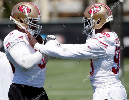 Lawrene Okoye, Aldon Smith San Francisco 49ers' Lawrence Okoye, left, trains with teammate Aldon Smith during an NFL football training camp, in Santa Clara, Calif
