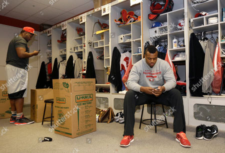 Lawrence Okoye, Tony Jerod-Eddie San Francisco 49ers' Tony Jerod-Eddie, left, and Lawrence Okoye clean their lockers at an NFL training facility in Santa Clara, Calif., . The 49ers lost to the Seattle Seahawks in the NFC Championship Game