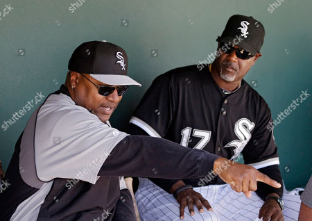 Former major league baseball and NFL football player Bo Jackson, left, talks with Chicago White Sox first base coach Daryl Boston (17) in the dugout before a spring exhibition baseball game against the Oakland Athletics, in Glendale, Ariz