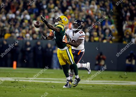 Josh Morgan, Ha Ha Clinton-Dix Chicago Bears wide receiver Josh Morgan (19) breaks up a pass intended for Green Bay Packers free safety Ha Ha Clinton-Dix (21) during the first half of an NFL football game, in Green Bay, Wis
